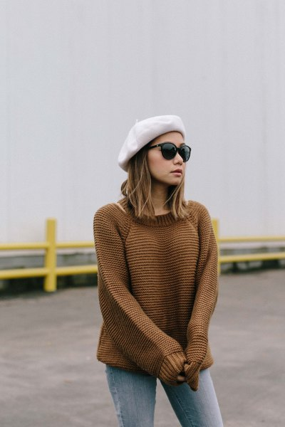 white paint hat with knitted sweater and gray jeans