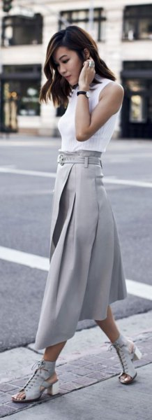 white sleeveless blouse with gray pleated midi skirt