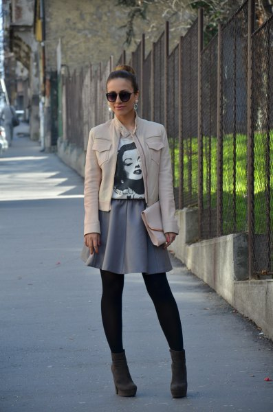white leather jacket with gray mini skater skirt