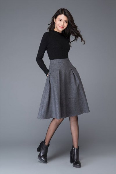 black shape that fits long sleeved tee with midi gray blown wool skirt