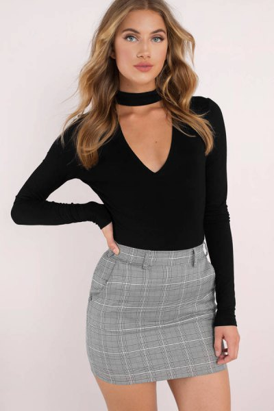 black cut-out deep v-neck shaped long sleeve top with tweed pencil skirt