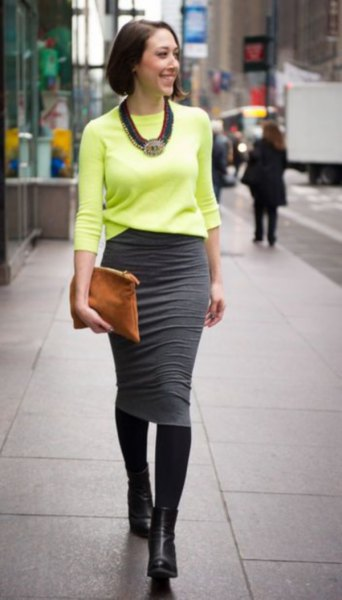 yellow knitted sweater with gray midi skirt