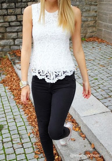 white seashell in lace case with black skinny jeans