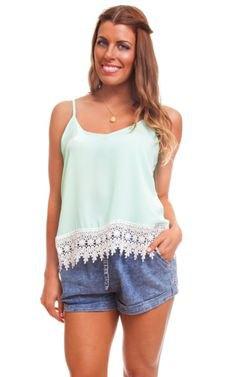 white lace hem top with blue mini-denim shorts