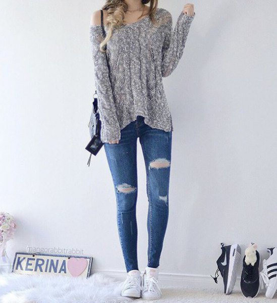 heather gray a shoulder knit sweater with blue ripped skinny jeans