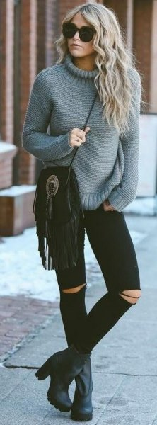 gray suede chunky knit sweater with black ripped skinny jeans