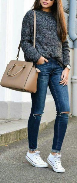 Heather gray sweater with blue jeans and pink handbag