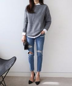 gray knitted sweater with white button up shirt and ripped skinny jeans