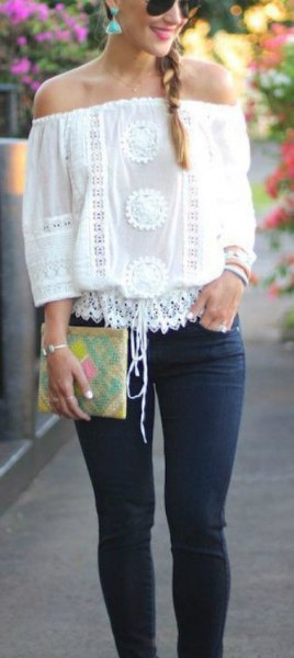 white crochet lace from shoulder top with slim jeans