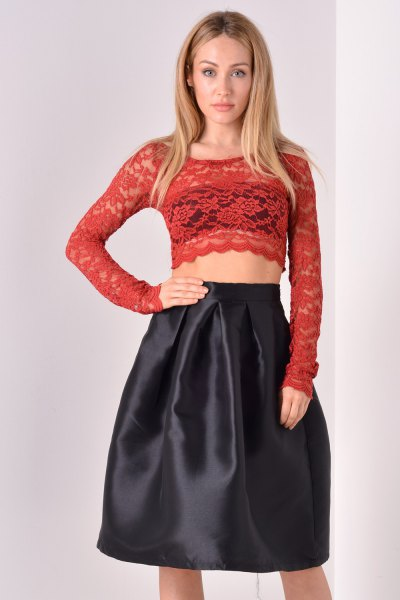 red long sleeve shape crop with black flared midi skirt