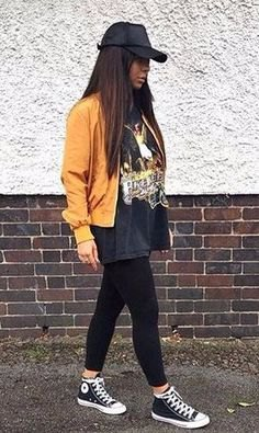 mustard yellow bomber jacket with black large tee t-shirt