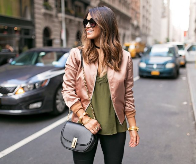 pink gold bomber jacket with green deep v-neck top