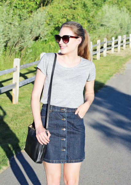 gray shirt neck t-shirt with dark blue button denim mini skirt