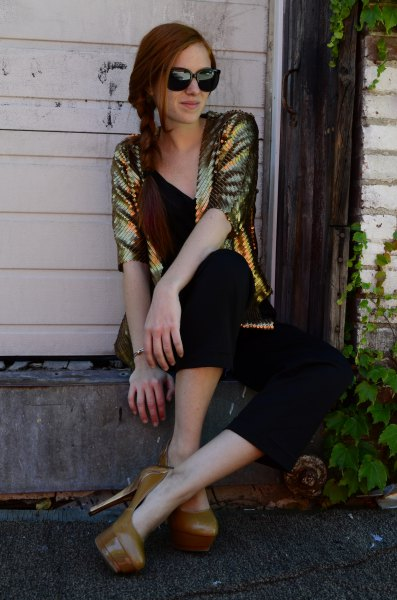 gold sequin jacket with black v-neck top and matching cropped trousers