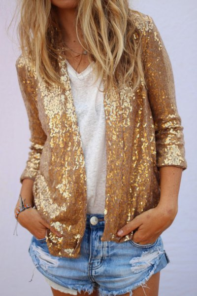 gold sequin jacket with blue mini-ripped denim shorts