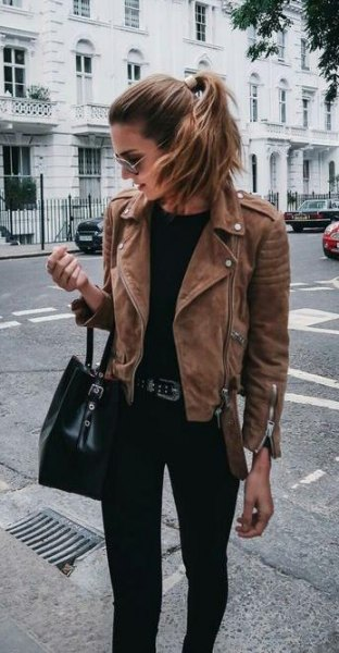 brown jacket with black handbag and matching jeans