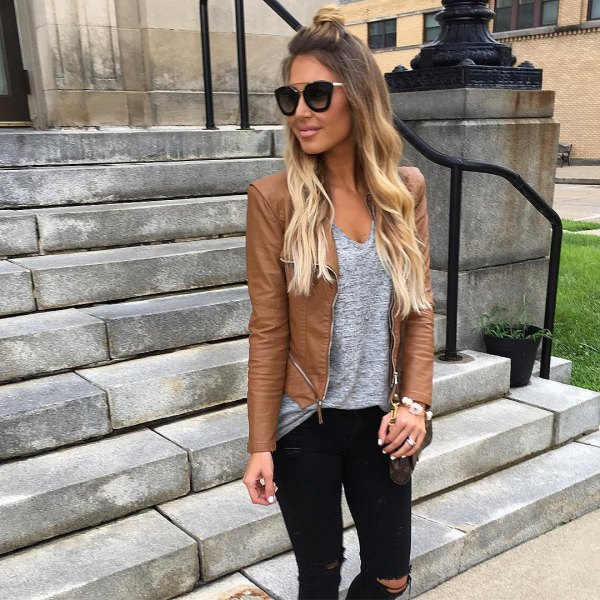 leather jacket with heather gray v-neck top and ripped jeans