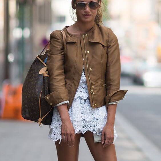 white lace mini dress with brown leather jacket