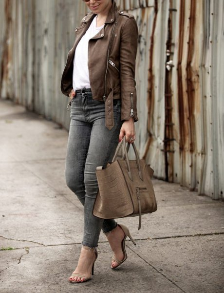 brown leather jacket with white blouse and gray skinny jeans