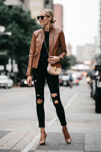 brown leather jacket with black ripped slim jeans