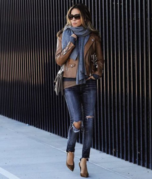 brown leather jacket with green tee and gray knitted scarf