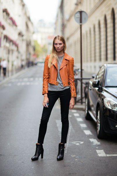 orange brown leather jacket with gray tee and black jeans