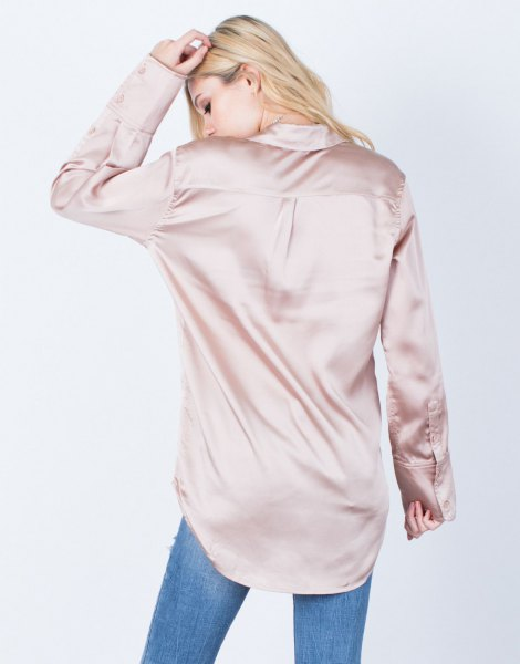 pink gold oversized button silk shirt with blue jeans