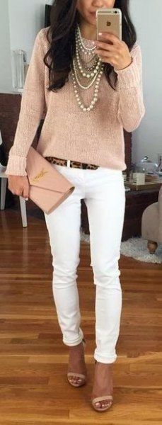 pink gold long sleeve top with skinny jeans
