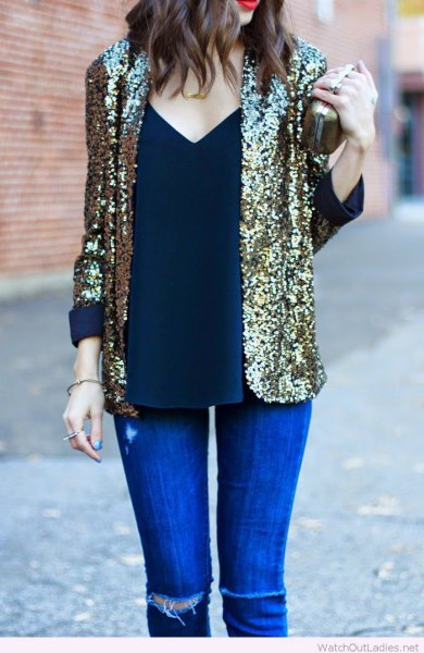 sequin blazer with deep v-top in the vest and royal blue skinny jeans