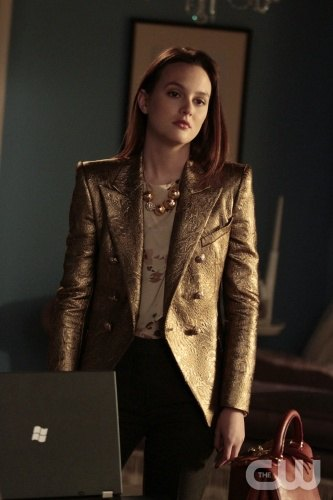 gold metallic blazer with white floral blouse and black jeans