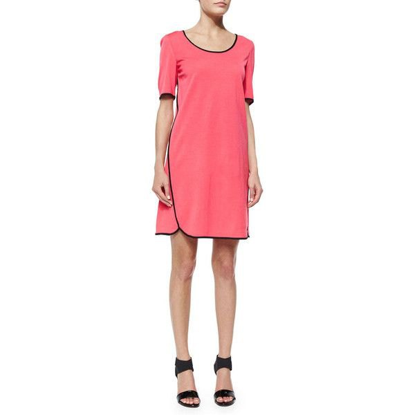pink short sleeve mini dress with black heeled sandals