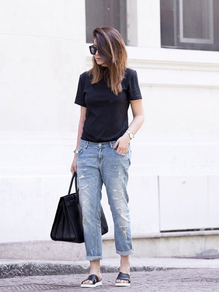 black t-shirt with cuffed boyfriend jeans and slide sandals