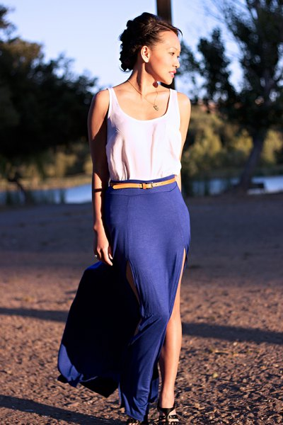 white top with yellow belt and blue high split skirt