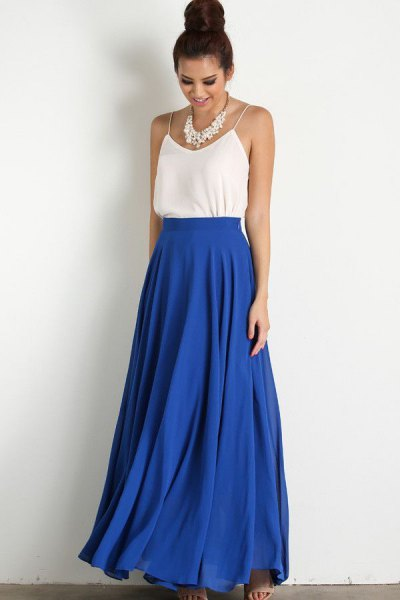 white spaghetti strap top with blue high waist skirt