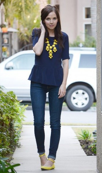 navy blue peplum top with yellow statement necklace