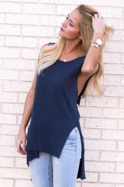 navy blue cutout top with light blue jeans