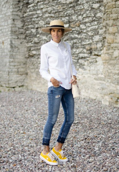 white button up shirt with cuffed jeans and yellow sneakers