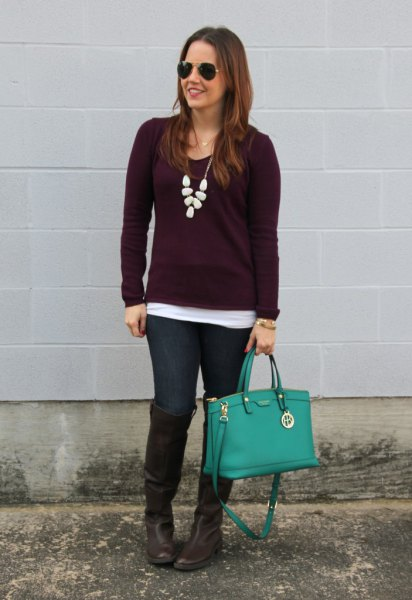 deep purple sweater with white statement necklace