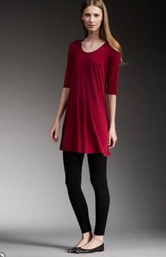 red half-heated tunic with black leggings and flats