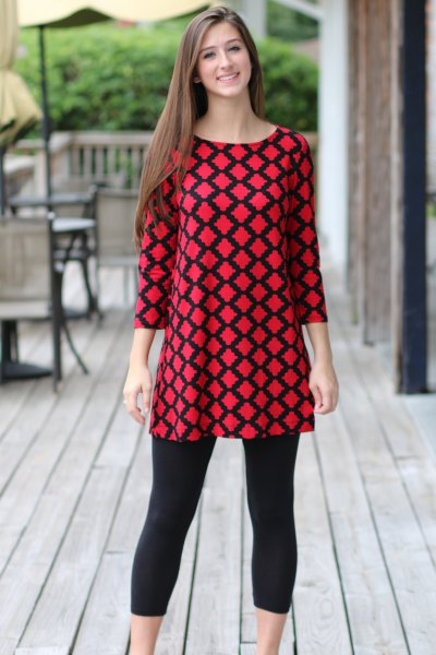 red and black patterned top with cropped leggings