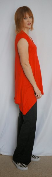 asymmetrical sleeveless tunic with black wide leg trousers
