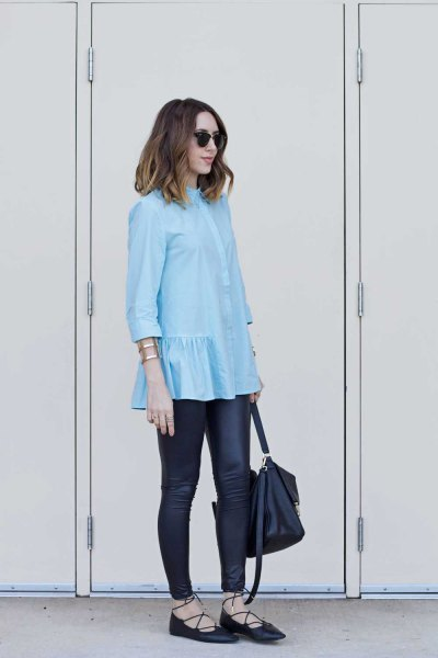 light blue ruffled blouse with black leather legs