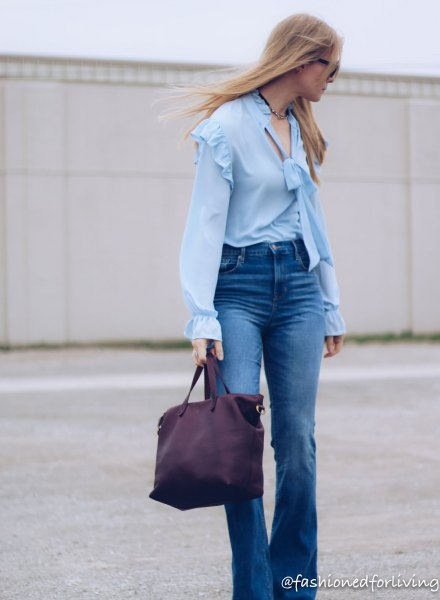 ruffle shoulder puff sleeve light blue blouse with puffed jeans