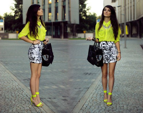 yellow button up chiffon shirt with black and white printed mini skirt