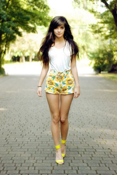white t-shirt with yellow printed mini shorts