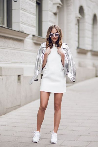 silver leather jacket with white mini dress