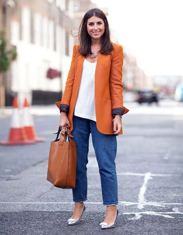 orange long blazer with white vest top and wide leg mom jeans