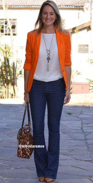 orange half-heated blazer with white top and dark blue blown jeans