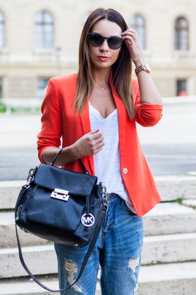 orange blazer with white deep v-neck vest and boyfriend jeans