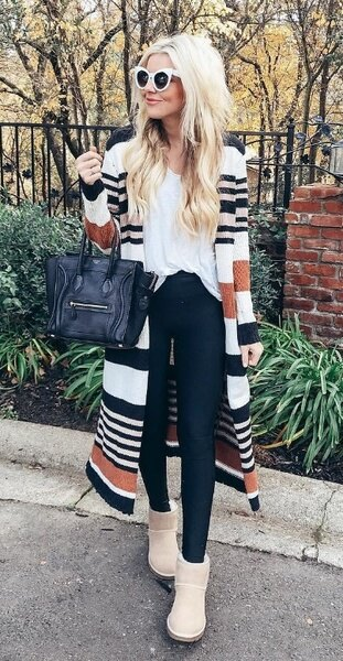 white t-shirt with multicolored striped long line and snow boots